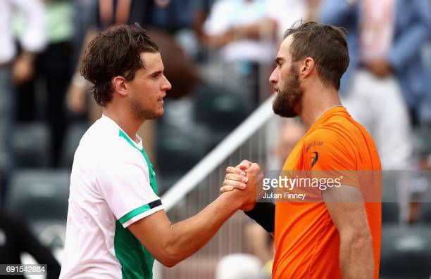 Steve Johnson of The United States congratulates Dominic Thiem of Austria on victory following the mens singles third round match on day six of the...