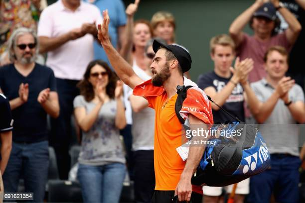 Steve Johnson of The United States leaves the court following defeat in mens singles third round match against Dominic Thiem of Austria on day six of...