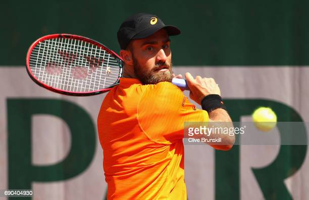 Steve Johnson of The United States plays a backhand during the mens singles second round match against Borna Coric of Croatia on day four of the 2017...