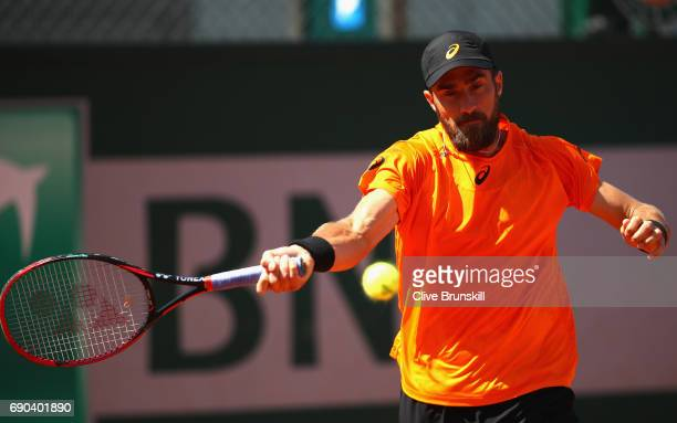 Steve Johnson of The United States plays a forehand during the mens singles second round match against Borna Coric of Croatia on day four of the 2017...