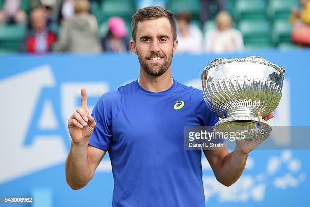 Steve Johnson of the United States poses with his trophy after defeating Pablo Cuevas of Uruguay in his men's singles final match during day six of...
