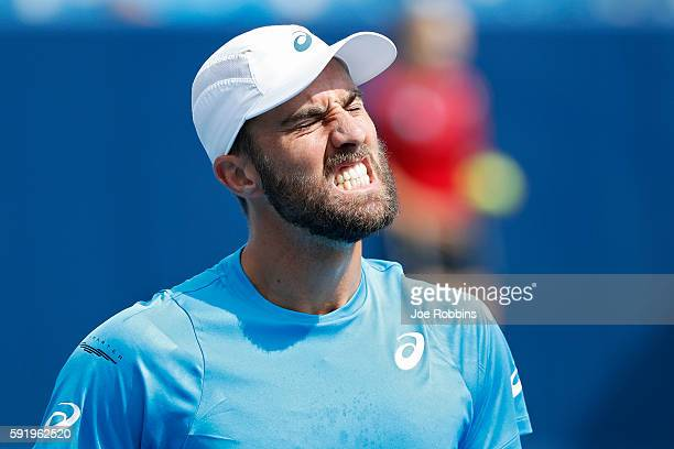 Steve Johnson of the United States reacts during a quarterfinal match against Grigor Dimitrov of Bulgaria on Day 7 of the Western Southern Open at...