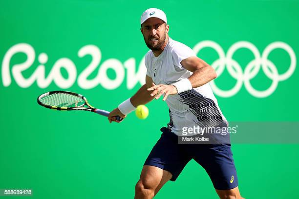 Steve Johnson of the United States returns a shot during against Andy Murray of Great Britain in the Men's Singles Quarterfinal on Day 7 of the Rio...