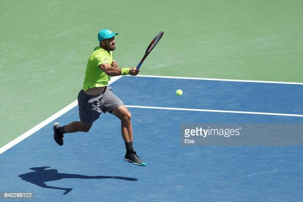 Steve Johnson of the United States returns a shot during his first round Men's Singles match against Nicolas Almagro of Spain on Day One of the 2017...