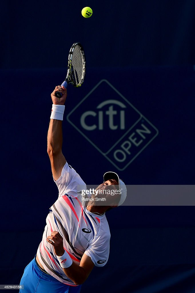 Steve Johnson of the United States serves a shot to John Isner of the United States during Day 3 of the Citi Open at the William H.G. FitzGerald Tennis Center on July 30, 2014 in Washington, DC.