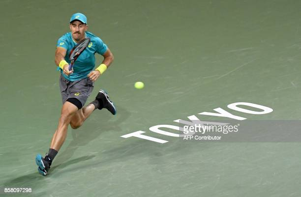 Steve Johnson of the US hits a return against Diego Schwartzman of Argentina during their men's singles quarterfinal match at the Japan Open tennis...