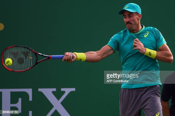 Steve Johnson of the US hits a return during the men's singles against Nick Kyrgios of Australia at the Shanghai Masters tennis tournament in...
