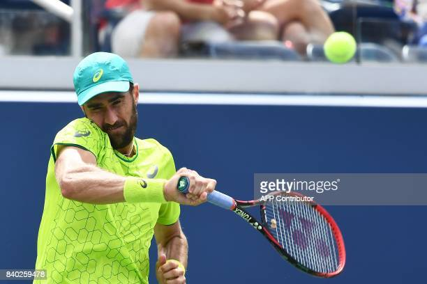 Steve Johnson of the US returns the ball to Spain's Nicolas Almagro during their 2017 US Open Men's Singles match at the USTA Billie Jean King...