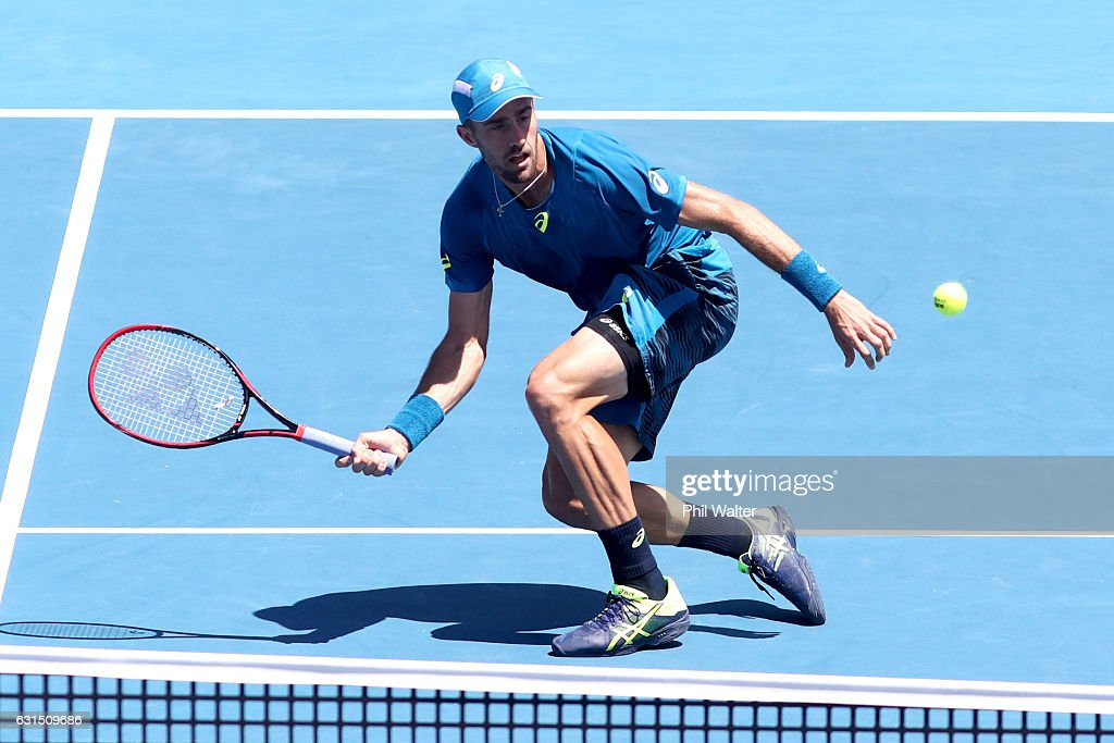 Steve Johnson of the USA plays a return during his mens singles match against John Isner of the USA serves during the ASB Classic on January 12, 2017 in Auckland, New Zealand.