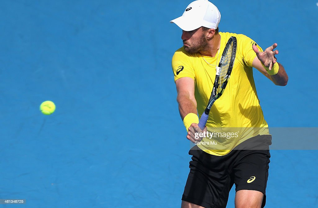 Steve Johnson of USA plays a backhand during his match against Kevin Anderson of South Africa on day three of the Heineken Open at ASB Tennis Centre on January 8, 2014 in Auckland, New Zealand.