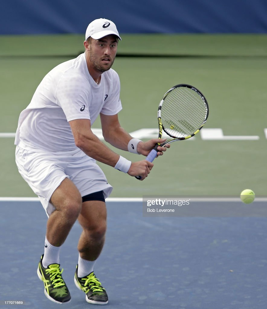 Steve Johnson waits to hit a return against Andreas Seppi of Italy on August 20, 2013 in Winston Salem, North Carolina.