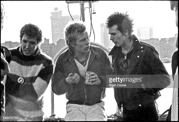 Steve Jones Paul Cook and Sid Vicious of English punk rock band the Sex Pistols aboard the Queen Elizabeth on the River Thames on June 7 1977 during...