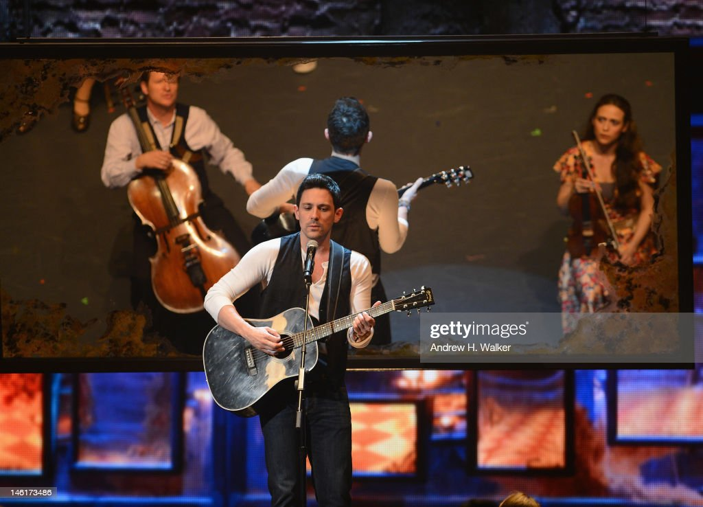 <a gi-track='captionPersonalityLinkClicked' href=/galleries/search?phrase=Steve+Kazee&family=editorial&specificpeople=5624843 ng-click='$event.stopPropagation()'>Steve Kazee</a> performs on stage with the case of 'Once the Musical' onstage at the 66th Annual Tony Awards at The Beacon Theatre on June 10, 2012 in New York City.