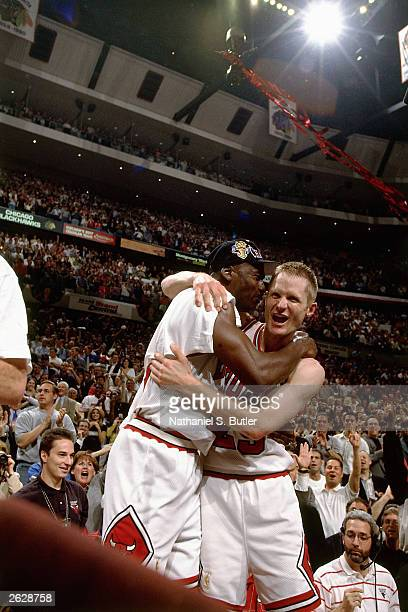 Steve Kerr and Michael Jordan of the Chicago Bulls celebrate after defeating the Utah Jazz to win the NBA Championship at the United Center circa...