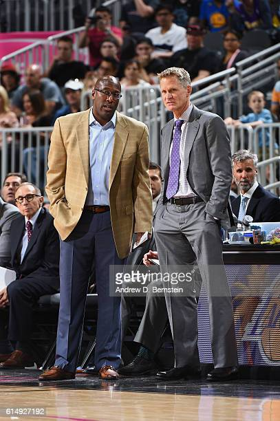 Steve Kerr and Mike Brown of the Golden State Warriors looks on against the Los Angeles Lakers during a preseason game on October 15 2016 at the...