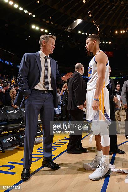 Steve Kerr and Stephen Curry of the Golden State Warriors talk after the game against the Indiana Pacers on December 5 2016 at ORACLE Arena in...