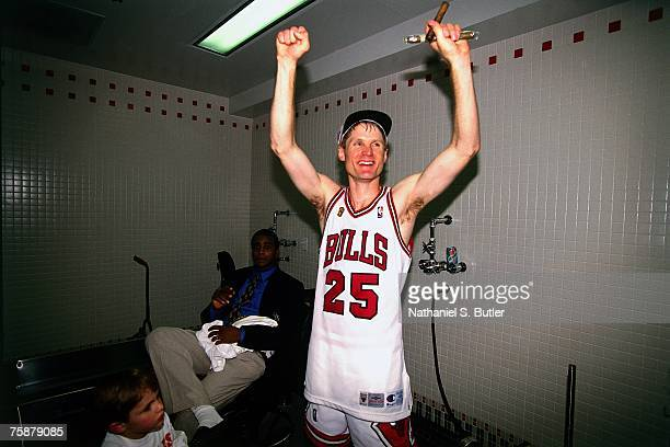 Steve Kerr of the Chicago Bulls celebrates winning the 1996 NBA Championship after defeating the Seattle SuperSonics in Game Six of the NBA Finals on...