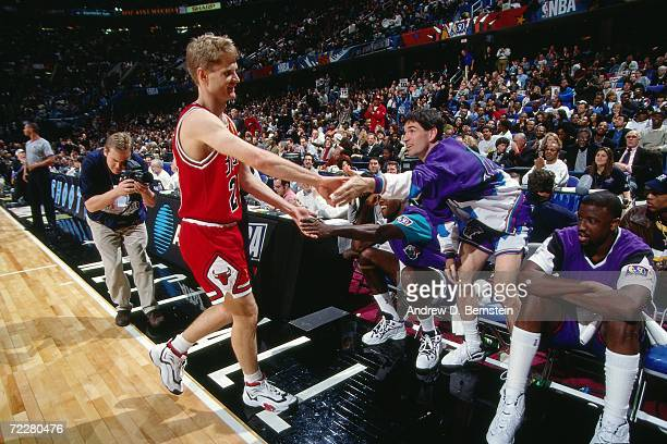 Steve Kerr of the Chicago Bulls shakes hands with John Stockton of the Utah Jazz during the 1997 ATT Three Point Shootout on February 8 1997 at the...