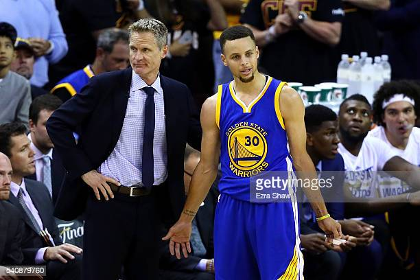 Steve Kerr of the Golden State Warriors and Stephen Curry react in the second half against the Cleveland Cavaliers in Game 6 of the 2016 NBA Finals...