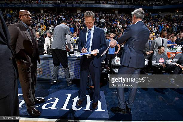 Steve Kerr of the Golden State Warriors draws a play out during the game against the Denver Nuggets on November 10 2016 at the Pepsi Center in Denver...
