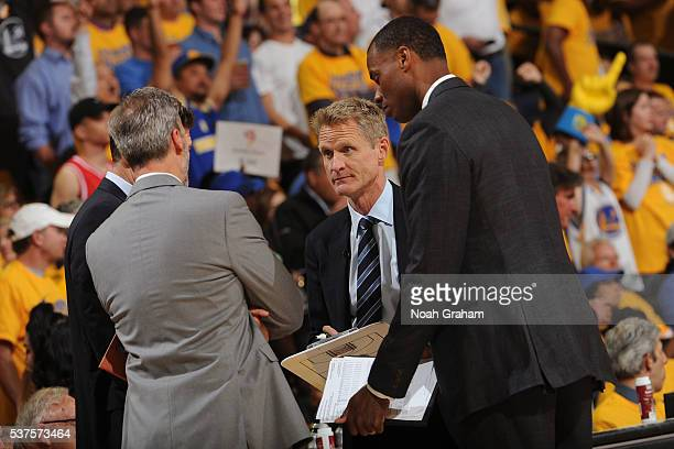 Steve Kerr of the Golden State Warriors huddles up his coaching staff in Game Five of the Western Conference Finals against the Oklahoma City Thunder...
