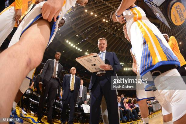 Steve Kerr of the Golden State Warriors huddles up with his team before Game Two of the Western Conference Quarterfinals against the Portland Trail...