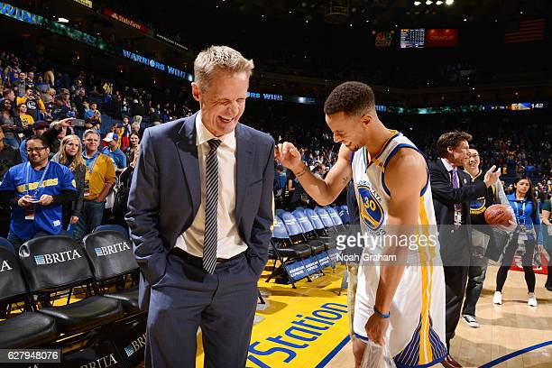 Steve Kerr of the Golden State Warriors talks with Stephen Curry of the Golden State Warriors after the game against the Indiana Pacers on December 5...