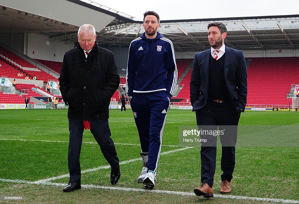 Steve Lansdown, Owner of Bristol City, Cole Skuse of Ipswich Town and Lee Johnson, Head Coach of Bristol City look on prior to the Sky Bet Championship match between Bristol City and Ipswich Town at Ashton Gate on February 13, 2016 in Bristol, England.