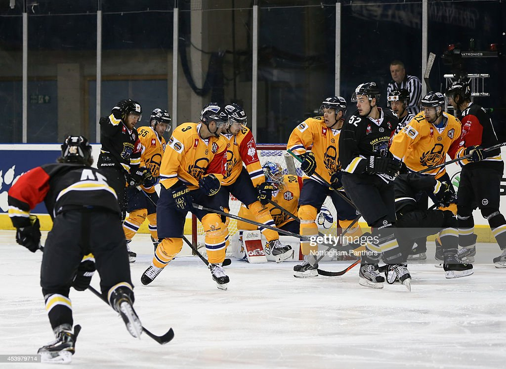 Steve Lee #45 of Nottingham Panthers scores the Nottingham Panthers first goal during the Champions Hockey League group stage game at the National Ice Centre in Nottingham, between Nottingham Panthers and Lukko Rauma on August 22, 2014 in Nottingham, United Kingdom.