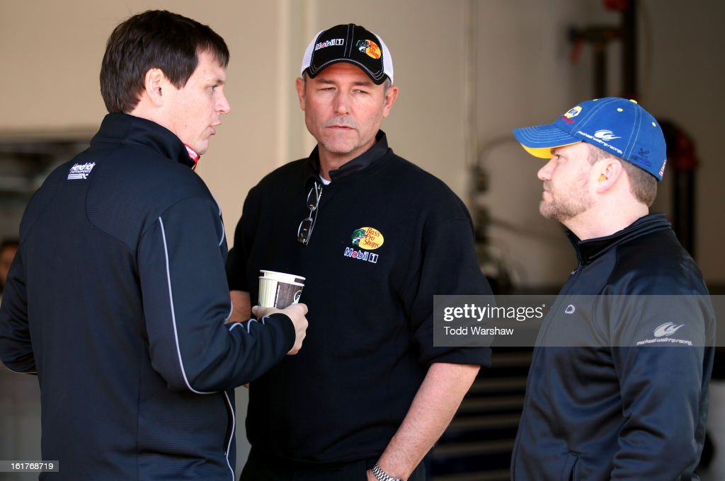 Steve Letarte, crew chief of the #88 National Guard Chevrolet, Steve Addington, crew chief of the #14 Mobil 1/Bass Pro Shops Chevrolet, and Chad Johnston, crew chief of the #56 NAPA Auto Parts Toyota, speak during practice for the NASCAR Sprint Cup Series Sprint Unlimited at Daytona International Speedway on February 15, 2013 in Daytona Beach, Florida.