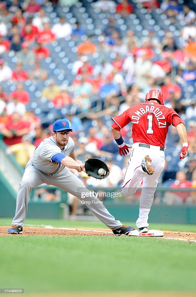Steve Lombardozzi #1 of the Washington Nationals is safe at first base in the third inning ahead of the throw to <a gi-track='captionPersonalityLinkClicked' href=/galleries/search?phrase=Ike+Davis&family=editorial&specificpeople=2349664 ng-click='$event.stopPropagation()'>Ike Davis</a> #29 of the New York Mets at Nationals Park on July 26, 2013 in Washington, DC.