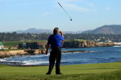 Steve Lowery tosses his putter in the air after missing a long birdie attempt on the eighteenth hole during the final round of the ATT Pebble Beach...