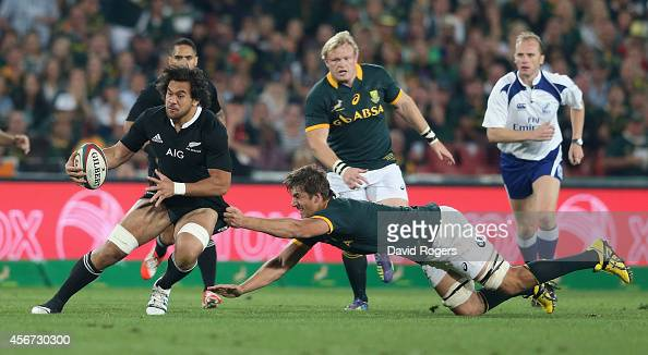 Steve Luatua of the All Blacks is held by Eben Etzebeth during the Rugby Championship match between the South African Springboks and the New Zealand...
