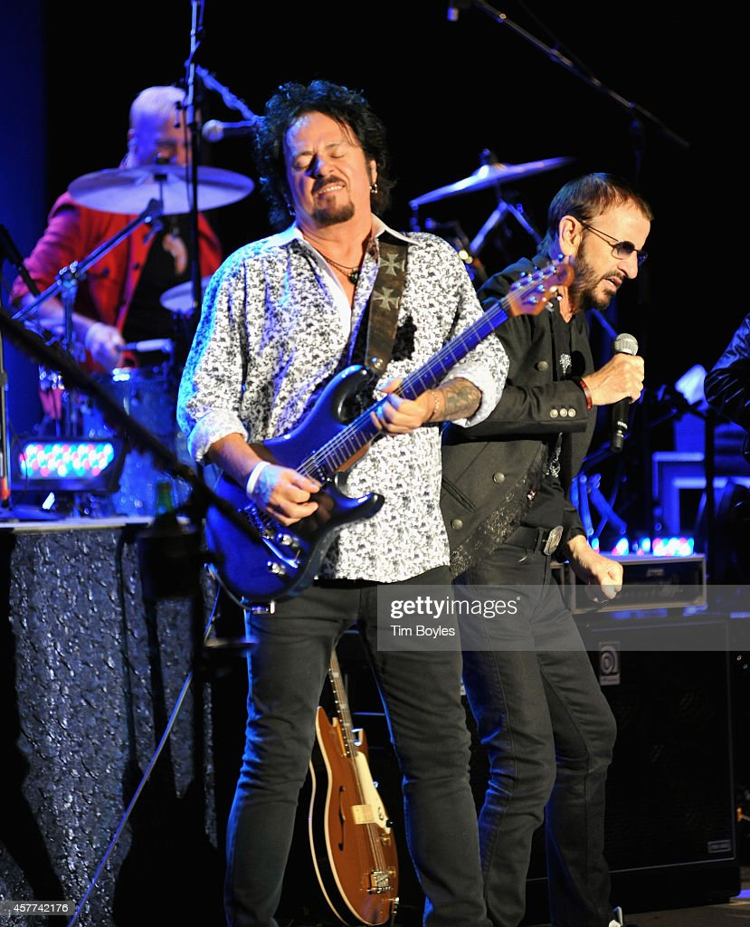 Steve Lukather (L) and Ringo Starr (R) of Ringo Starr & His All-Starr Band perform at Ruth Eckerd Hall on October 23, 2014 in Clearwater, Florida.