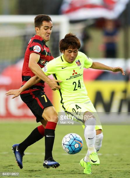 Steve Lustica of the Wanderers competes for the ball against Takahiro Sekine of Urawa Red Diamonds during the AFC Asian Champions League match...