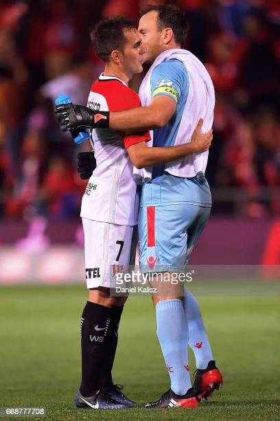 Steve Lustica of the Wanderers congratulates United goalkeeper Eugene Galekovic during the round 27 ALeague match between Adelaide United and the...