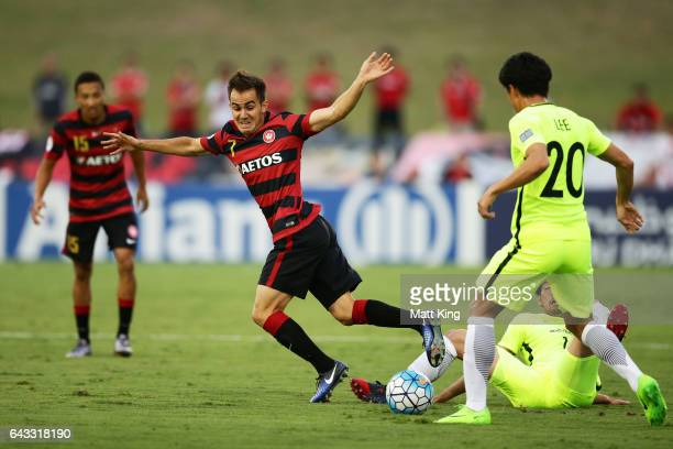 Steve Lustica of the Wanderers is challenged during the AFC Asian Champions League match between the Western Sydney Wanderers and the Urawa Red...