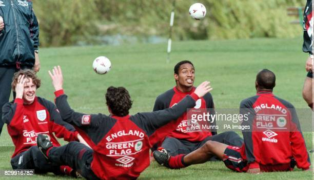 Steve MacManaman and Paul Ince practice headers with teamates during this morning's practice session at Bisham Abbey England play Georgia at Wembley...