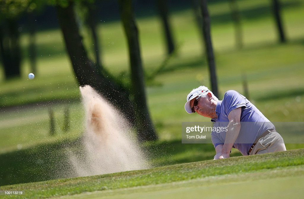 Steve Maddox of Ashton-on-Mersey plays out the bunker on the 5th hole during the Virgin Atlantic PGA National Pro-Am Championship Regional Qualifier at Dunham Forest Golf and Country Club on May 21, 2010 in Manchester, England.