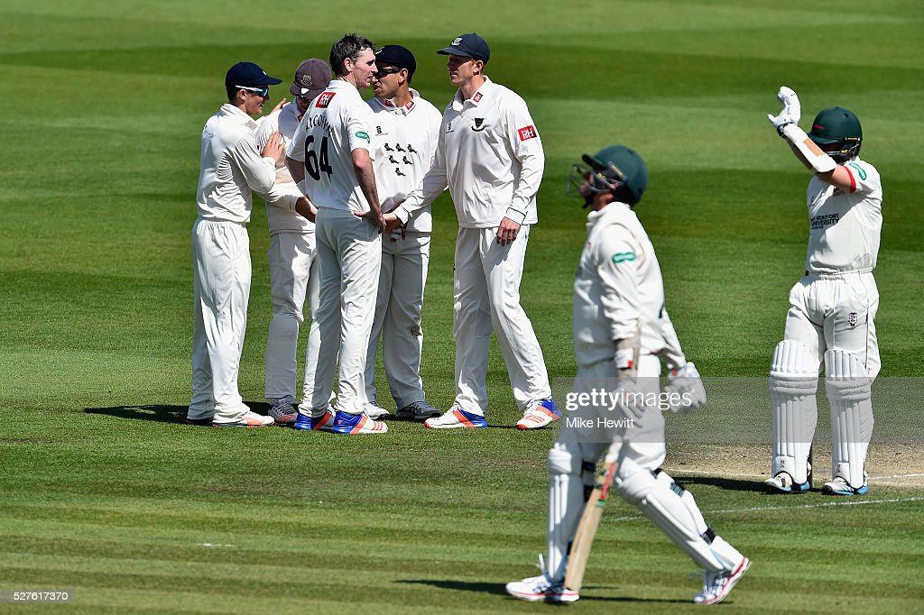 Steve Magoffin of Sussex is congratulated by team mates after taking the wicket of Clint McKay of Leicestershire during the Specsavers County Championship Division Two match between Sussex and Leicestershire on May 03, 2016 in Hove, England.
