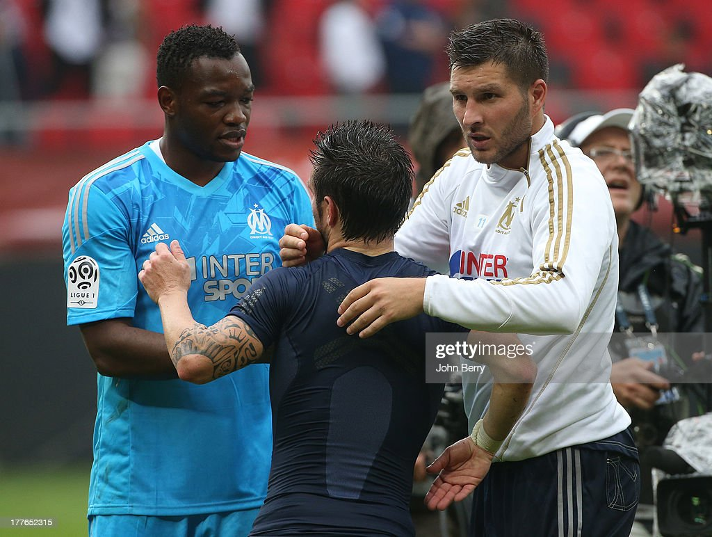 <a gi-track='captionPersonalityLinkClicked' href=/galleries/search?phrase=Steve+Mandanda&family=editorial&specificpeople=4470005 ng-click='$event.stopPropagation()'>Steve Mandanda</a>, goalkeeper of OM, <a gi-track='captionPersonalityLinkClicked' href=/galleries/search?phrase=Mathieu+Valbuena&family=editorial&specificpeople=778610 ng-click='$event.stopPropagation()'>Mathieu Valbuena</a> of OM and <a gi-track='captionPersonalityLinkClicked' href=/galleries/search?phrase=Andre-Pierre+Gignac&family=editorial&specificpeople=1272457 ng-click='$event.stopPropagation()'>Andre-Pierre Gignac</a> of OM congratulate each other after the French Ligue 1 match between Valenciennes FC and Olympique de Marseille OM at the Stade du Hainaut stadium on August 24, 2013 in Valenciennes, France.