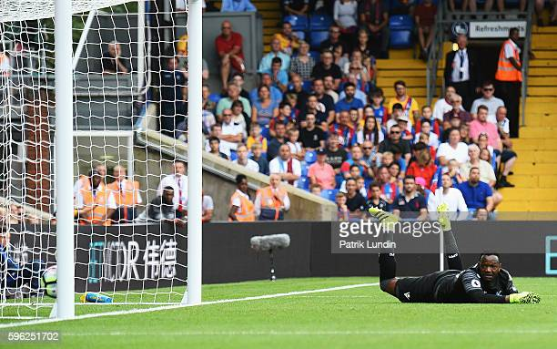 Steve Mandanda of Crystal Palace watches as the ball crosses the line during the Premier League match between Crystal Palace and AFC Bournemouth at...