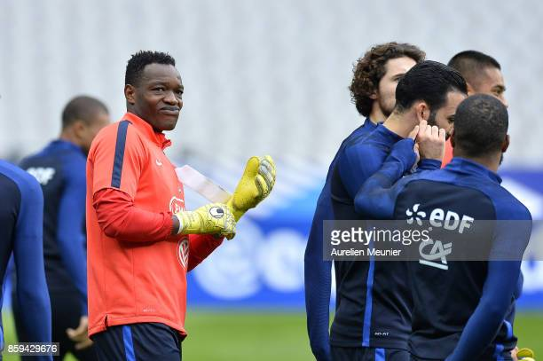 Steve Mandanda of France reacts before a France training session ahead of the France v Belarus FIFA 2018 World Cup Qualifier at Stade de France on...