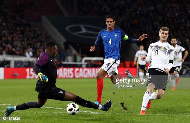 Steve Mandanda of France saves from Timo Werner of Germany during the international friendly match between Germany and France at RheinEnergieStadion...