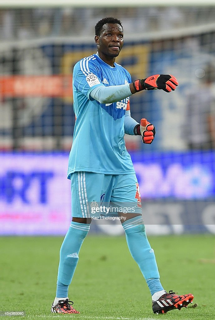 <a gi-track='captionPersonalityLinkClicked' href=/galleries/search?phrase=Steve+Mandanda&family=editorial&specificpeople=4470005 ng-click='$event.stopPropagation()'>Steve Mandanda</a> of Marseille in action during the French Ligue 1 match between Olympique de Marseille and OGC Nice at Stade Velodrome on August 29, 2014 in Marseille, France.