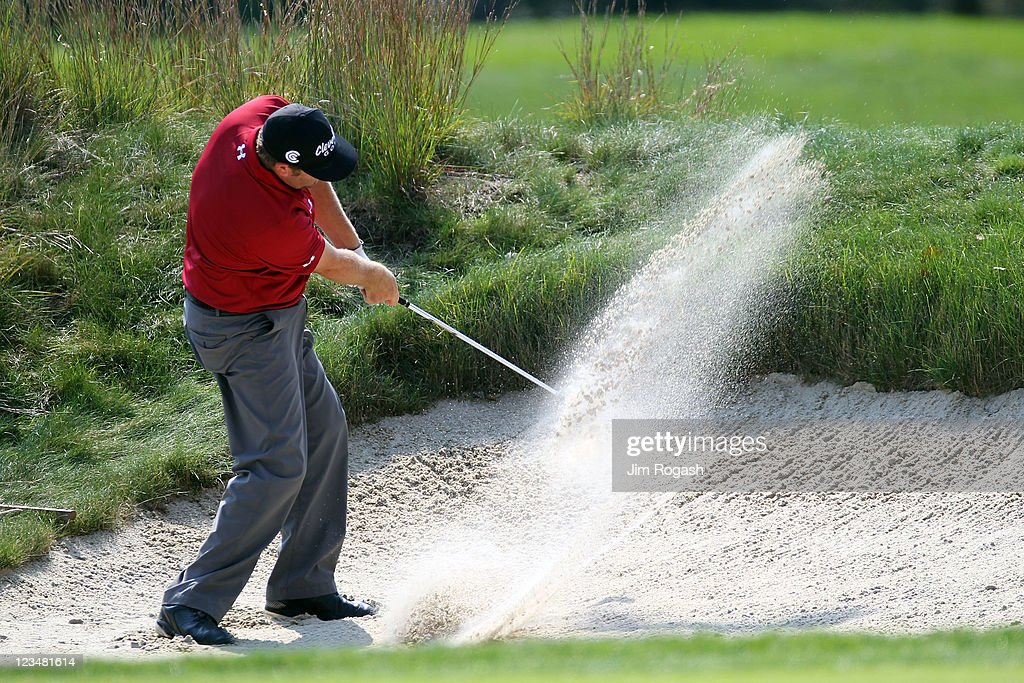 Steve Marino hits a shot out of the bunker on the 14th hole during the second round of the Deutsche Bank Championship at TPC Boston on September 3, 2011 in Norton, Massachusetts.