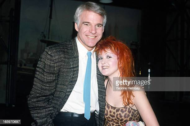 Steve Martin and Cindy Lauper pose for a photograph on the set of Lorne Michael's 'The New Show' January 5 1984 in New York City
