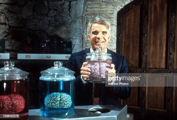 Steve Martin holding jar of brains in a scene from the film 'The Man With Two Brains' 1983