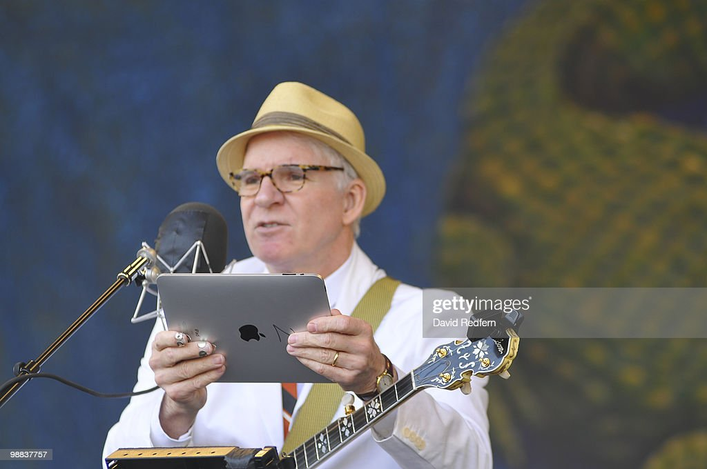 Steve Martin performs on day four of New Orleans Jazz & Heritage Festival on April 29, 2010 in New Orleans, Louisiana. He holds up an ipad.