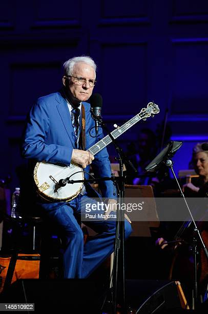 Steve Martin performs with the Boston Pops and The Steep Canyon Rangers at Symphony Hall on May 31 2012 in Boston Massachusetts